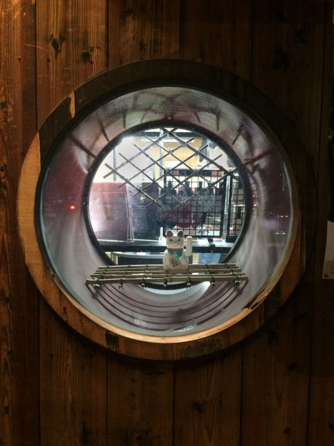 Neko inside circular window