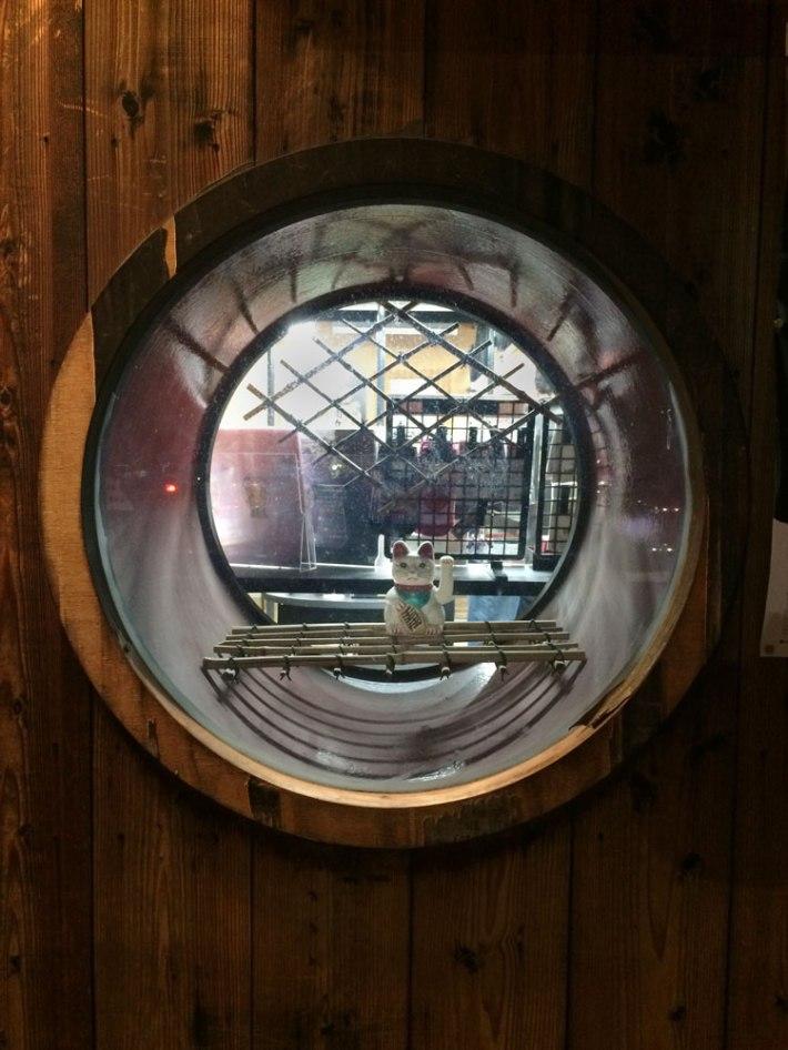 Neko inside circular window