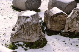 Broken column with snow