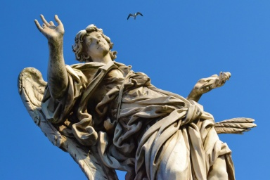 Angel statue with flying bird