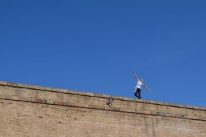 Balancing woman on wall