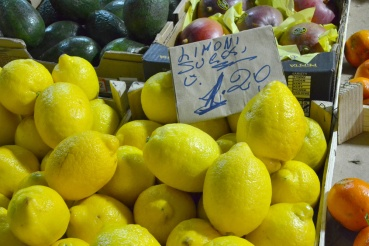 Big bright lemons at an italian market